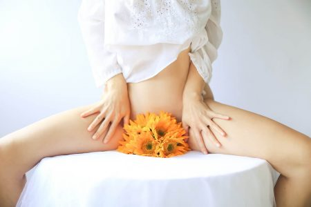 Woman with flowers in crotch - Yoni Care and Healing Vaginal Tears After Birth